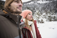 Couple on a trip in winter looking around - SUF00442