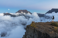 Reunion, Maido viewpoint, View from volcano Maido to Cirque de Mafate, Gros Morne and Piton des Neiges, photographer, moon rise - FOF09668