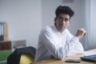 Portrait of content businessman at desk - SGF02144