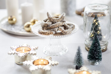 Poppy seed cookies on glass cake stand at Christmas time - SBDF03441