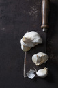 Garlic on rusty cleaver and ground - CSF28681