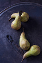 Four green pears 'Abate Fetel' and an old knife on rusty ground - CSF28690