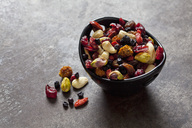 Bowl of dried fruits, pistachios, cashew nuts and almonds - CSF28705