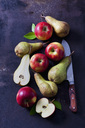Sliced and whole apples and pears  on dark ground - CSF28723