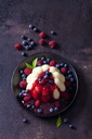 Custard with raspberries, blueberries and raspberry sauce on plate - CSF28732