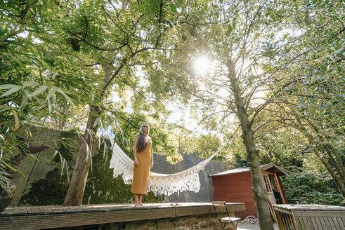 Woman relaxing in her garden - KNSF03508