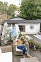 Woman relaxing on terrace - KNSF03526