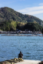 Japan, Kyoto Prefecture, fishing village Ine, townscape with angler - THAF02084