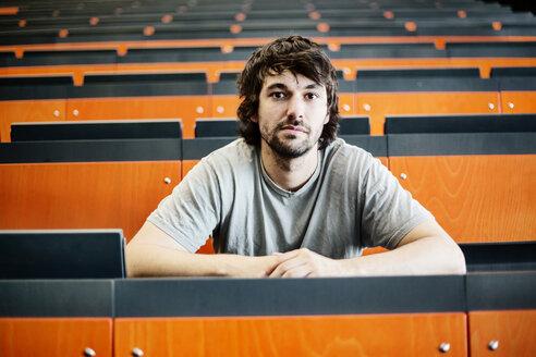 Portrait of student in auditorium at university - JATF00981
