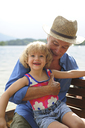 Portrait of little girl in rowing boat with her grandfather - ECPF00146