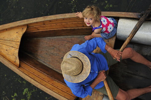 Happy little girl with her grandfather  in rowing boat, top view - ECPF00155