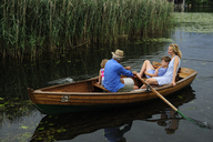 Family in rowing boat on lake - ECPF00158