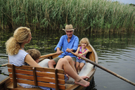 Family in rowing boat on lake - ECPF00161