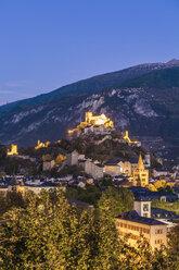 Switzerland, Canton Vaud, Sion, townscape with Notre-Dame de Valere and Notre Dame du Glarier at dusk - WDF04310