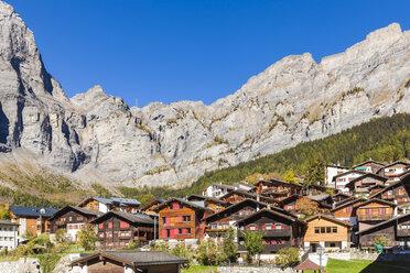 Switzerland, Valais, Leukerbad, houses and mountain massif - WDF04319