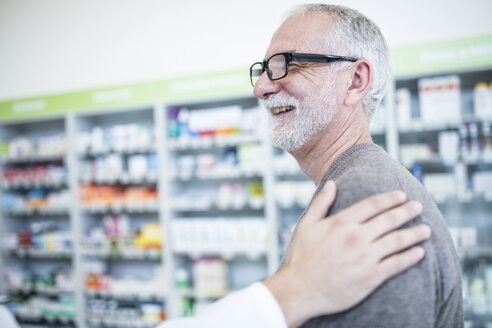 Smiling customer in pharmacy - WESTF23941