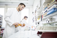 Man and woman working in laboratory of a pharmacy - WESTF24007