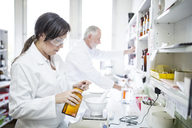 Man and woman working in laboratory of a pharmacy - WESTF24010