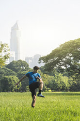 Runner warming up in urban park - SBOF01116