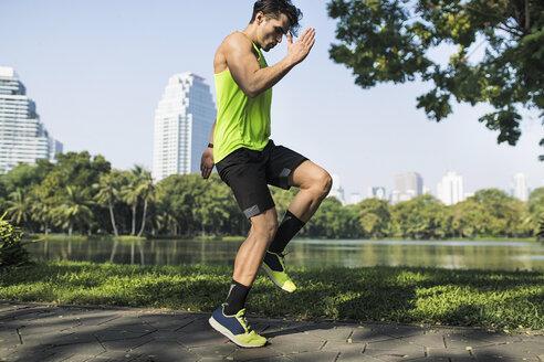 Runner warming up in urban park - SBOF01137