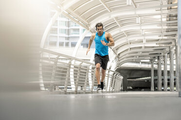 Fit man running on a bridge in the city - SBOF01158