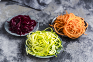 Bowl of Zoodles and bowls of carrot  and beetroot spaghetti - SARF03470