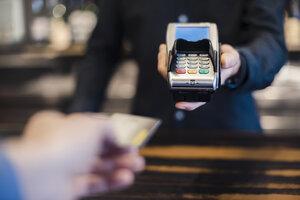 Man using credit card reader, close-up - DIGF03222