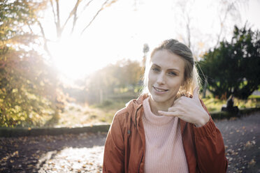 Portrait of young woman in autumnal park - JOSF02151