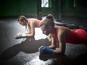Two women having a workout in a hall - CVF00005