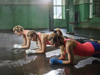 Three women having a workout in a hall - CVF00011