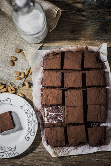 Homemade brownies on parchment paper - GIOF03752