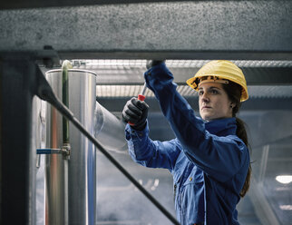 Craftswoman wearing hard hat at work - CVF00029