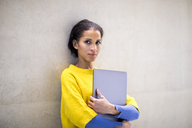 Portrait of young woman with laptop - FMKF04703