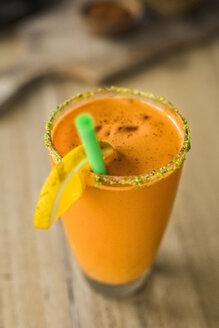 Orange smoothie with carrots and lemon slice - SBOF01238