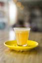 Orange beverage in glass on wooden tale - SBOF01241