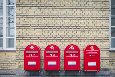 Denmark, Aarhus, row of four mailboxes in front of facade - KEB00709