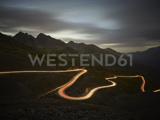 Austria, Tyrol, Kaunertal, road in the evening, light trails - CVF00035