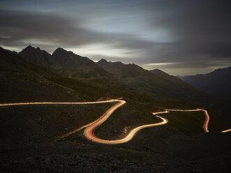 Austria, Tyrol, Kaunertal, road in the evening, light trails - CVF00035