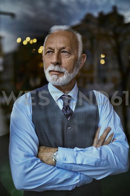 Elegant senior man looking out of window - ZEDF01115