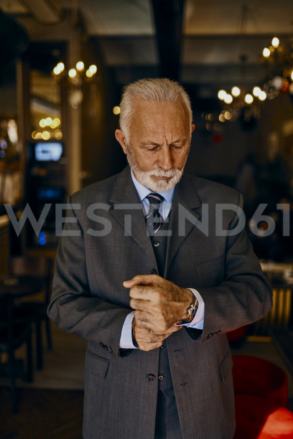Elegant senior man adjusting his cuffs - ZEDF01166