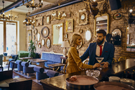 Elegant couple having a drink in a bar - ZEDF01181