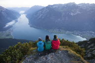 Austria, Tyrol, three hikers enjoying the view on Achensee - FAF00079