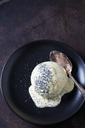 Yeast dumpling with vanilla sauce and poppy seed on plate - CSF28761