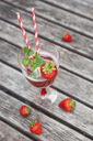 Strawberry lemonade in glass with drinking straws - GWF05388