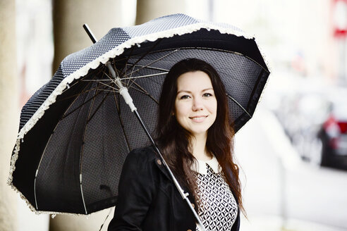 Portrait of fashionable young woman with black vintage umbrella - JATF00994