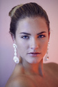 Portrait of lascivious young woman wearing earings - PNEF00388