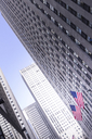 USA, New York City, Manhattan, skyscraper with American flags - CMF00777