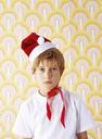 Portrait of boy in bad mood wearing Christmas cap - FSF00977