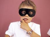 Portrait of little boy wearing black eye mask - FSF00983