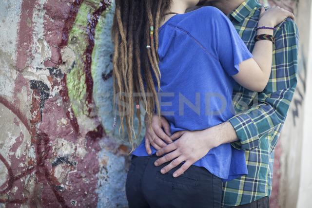 Close-up of couple kissing at graffiti wall - LFEF00018